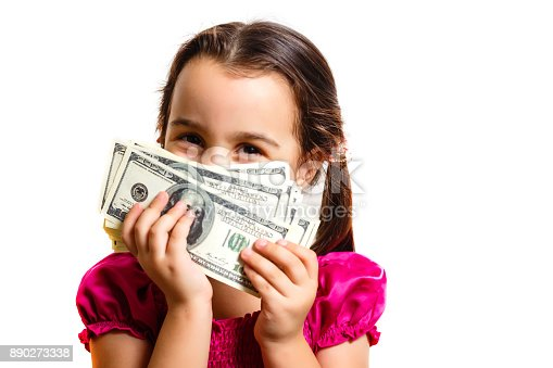 istock Happy child with money dollar. Isolated. On a white background. 890273338