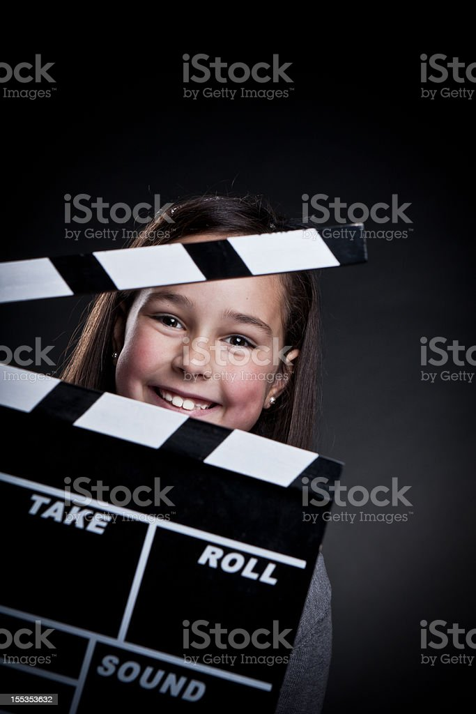 Happy child with movie clapper board. royalty-free stock photo