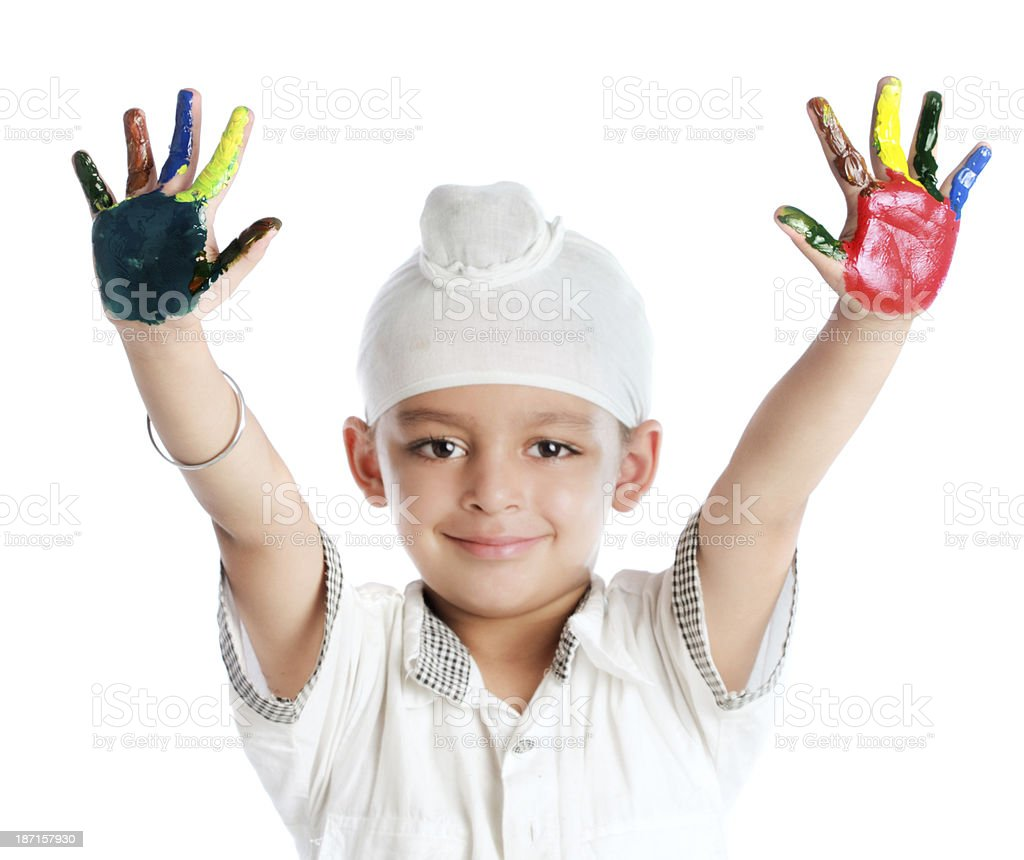 Happy child with painted hands stock photo