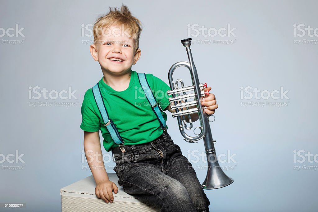 Happy child with trumpet stock photo