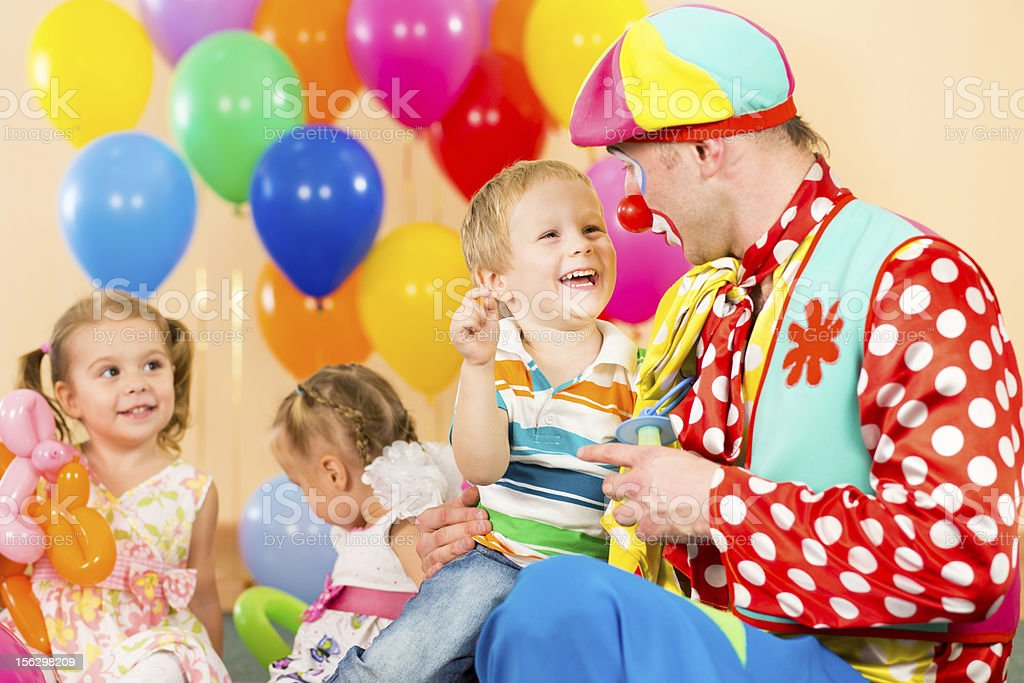 happy children and clown on birthday party royalty-free stock photo