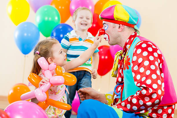 happy children and clown on birthday party stock photo