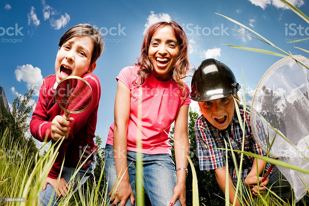 Happy Children and Teacher Discovery in the Nature stock photo