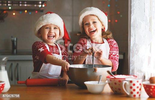 istock happy children bake christmas cookies 870426758