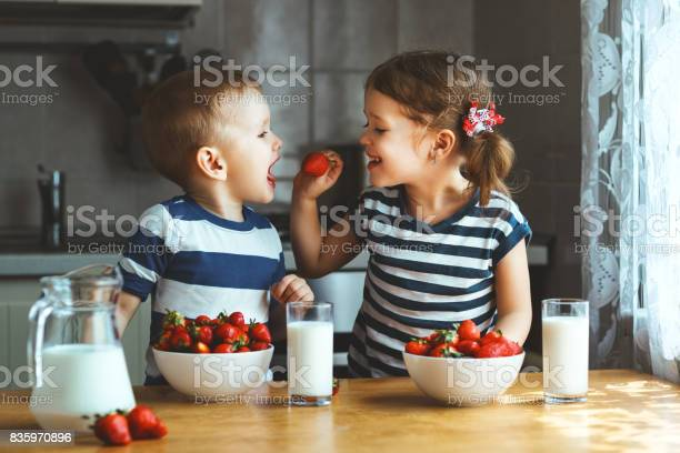 Happy children brother and sister eating strawberries with milk picture id835970896?b=1&k=6&m=835970896&s=612x612&h=apwso4ich7okglbmri1g1bjh gry7fiersxmqbvqssw=
