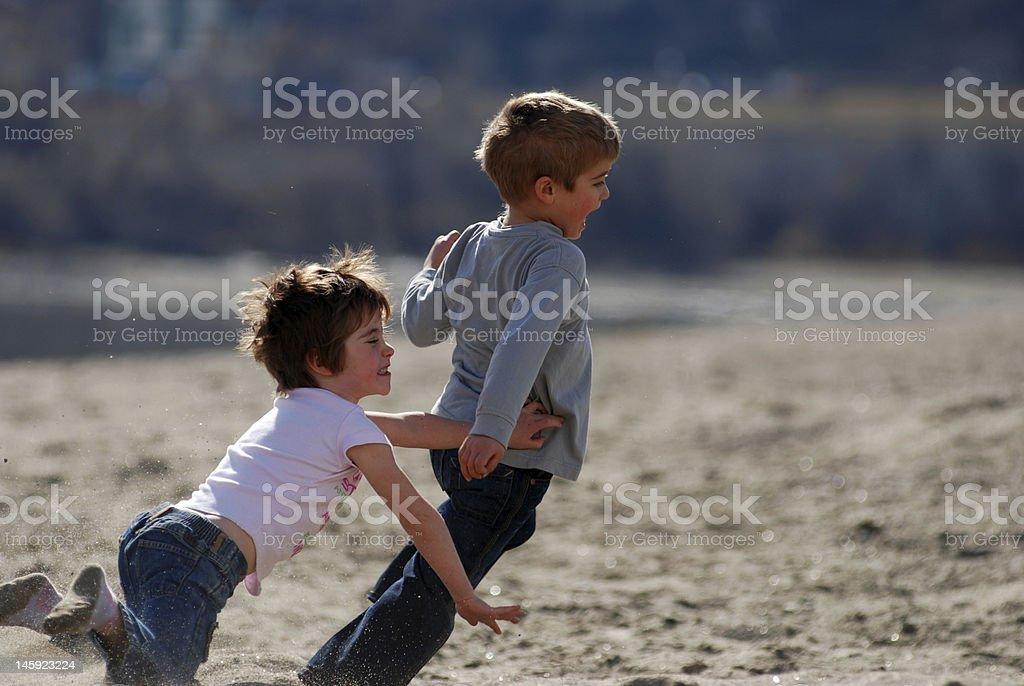 happy children chasing stock photo