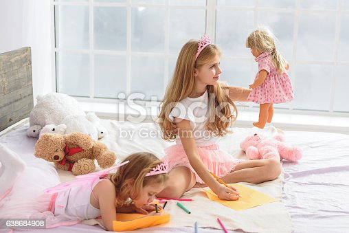 istock Happy children creating images in house 638684908