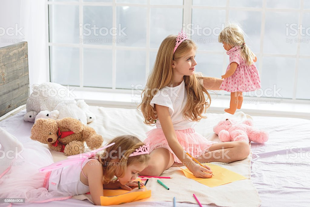 Happy children creating images in house stock photo