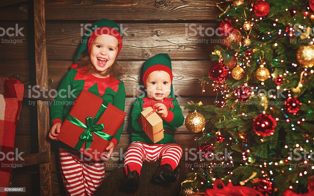 Happy Children Elf Helper Of Santa With Christmas Gift Stock Photo ...