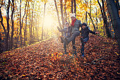 Three kids enjoying autumn in forest. Kids are aged 8 and 11. Nikon D850