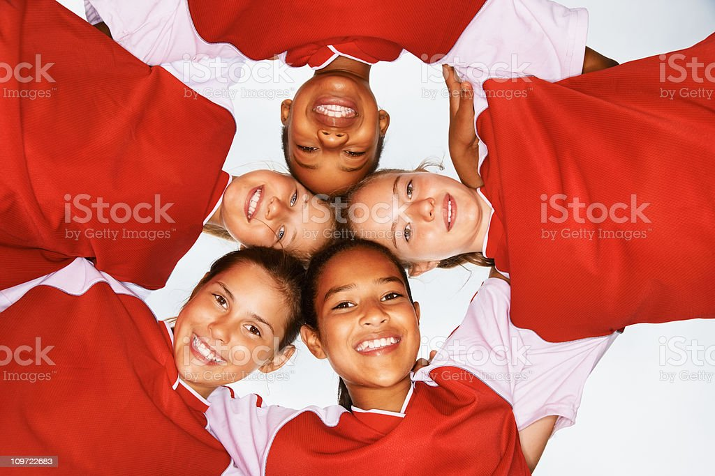 Happy children forming a victory huddle royalty-free stock photo