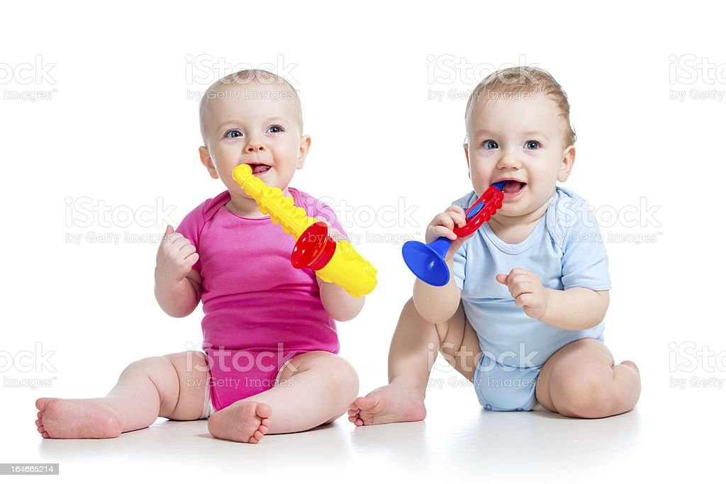 Happy children girl and boy playing with musical toys stock photo