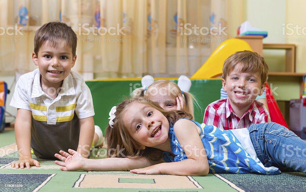 Happy children having fun at home stock photo