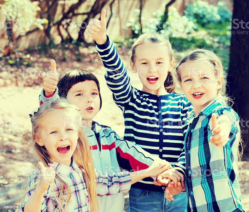 Happy  children holding hands and giving friendship royalty-free stock photo