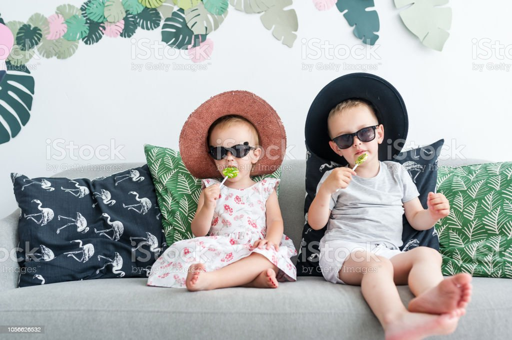 Swell Happy Children In Glasses And Hats Eat Tasty Lollipops Machost Co Dining Chair Design Ideas Machostcouk