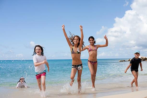 happy children on the beach stock photo