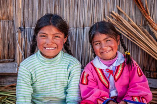 Happy children on Uros floating island, Lake Tititcaca, Peru stock photo