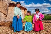 istock Happy children on Uros floating island, Lake Tititcaca, Peru 1306125619