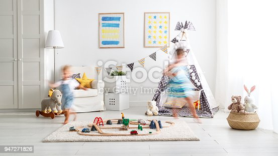 500939056 istock photo happy children playing and run  at home in   playroom 947271826