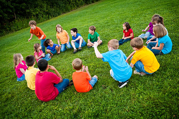 Happy Children Playing Duc, Duck, Goose Outside stock photo