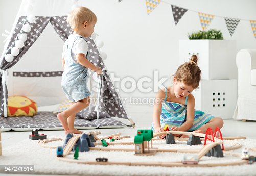 500939056 istock photo happy children playing in toys at home in   playroom 947271914