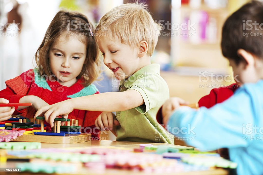 Happy children playing together. stock photo