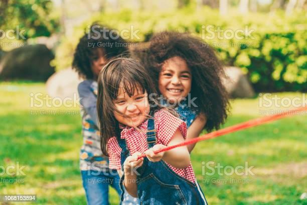 Happy children playing tug of war and having fun during summer in picture id1068153894?b=1&k=6&m=1068153894&s=612x612&h=pffj3s8egqu6owtjiwcdfl pgq7dffo3lj mcyxqolu=