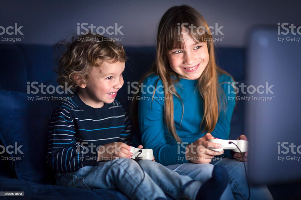 Happy children playing video games royalty-free stock photo