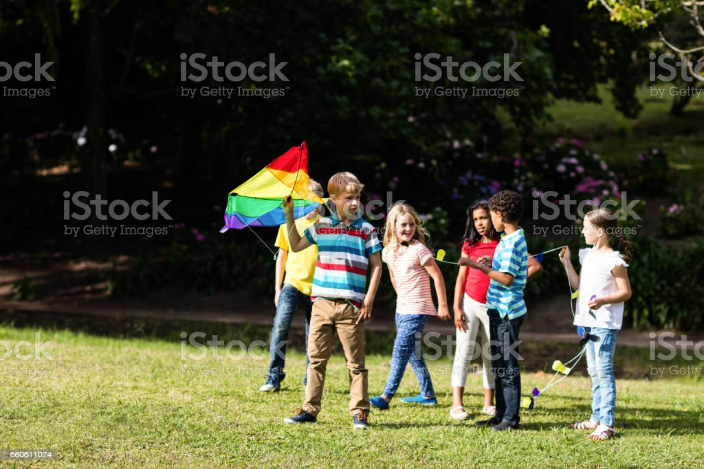 Happy children playing with a kite royalty-free stock photo