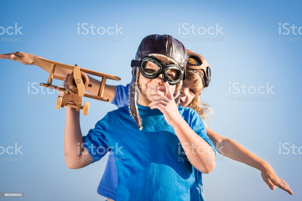 Happy children playing with toy airplane royalty-free stock photo