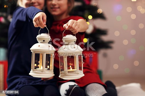 Picture showing happy children posing with Christmas lanterns