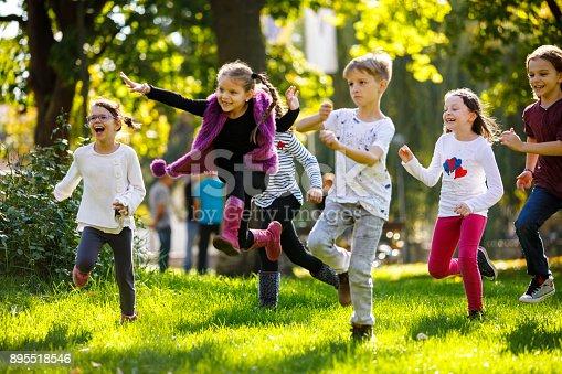 Happy children running outside