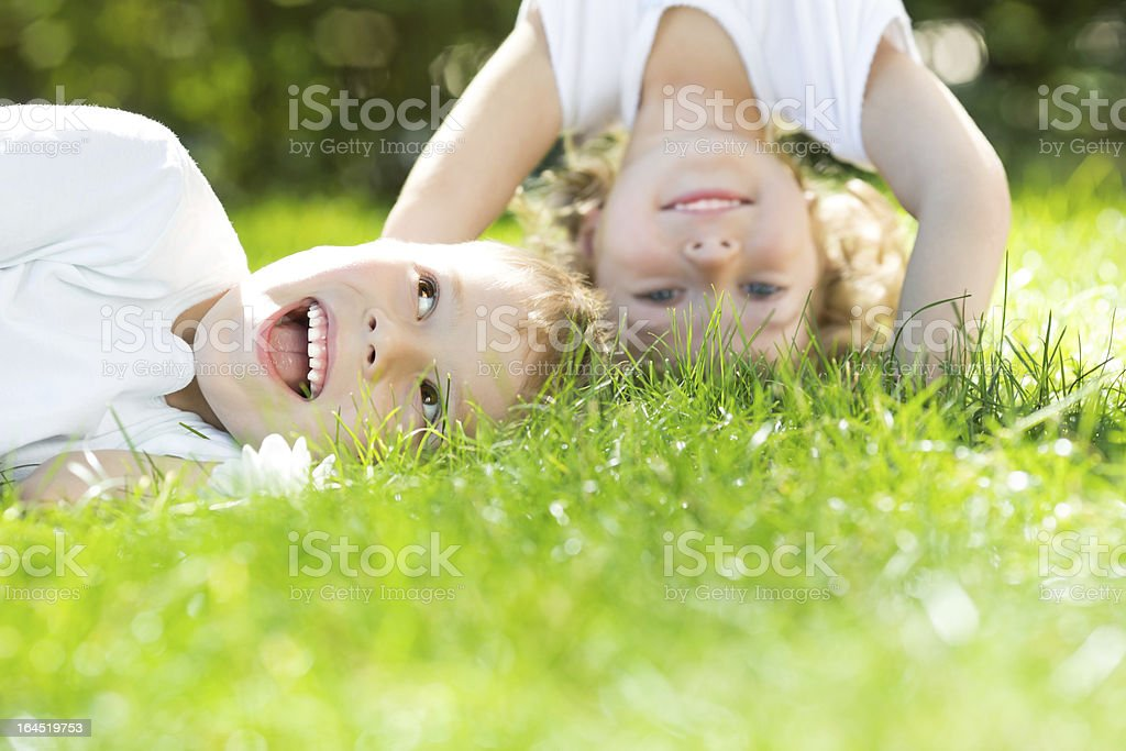 Happy children standing upside down stock photo