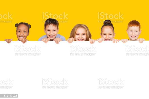 Happy children with empty board yellow background picture id1172147023?b=1&k=6&m=1172147023&s=612x612&h=udp9ig7hxyg32r7u 6byeqlzoc2mdrj9r5 tadk loe=