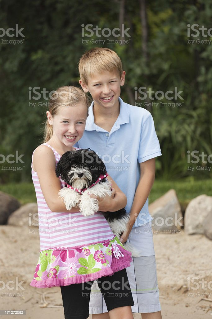 Happy Children with Family Pet Dog on the Beach royalty-free stock photo
