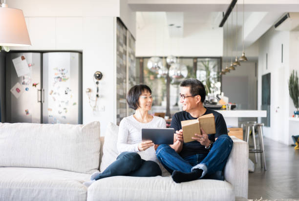 Happy Chinese couple at home stock photo