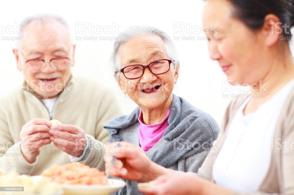 happy chinese family making dumpling together royalty-free stock photo