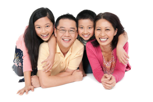 Happy Chinese Family of Four stock photo