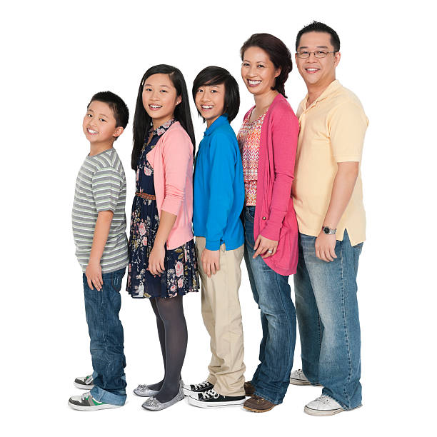 Happy Chinese Family Standing In Line stock photo