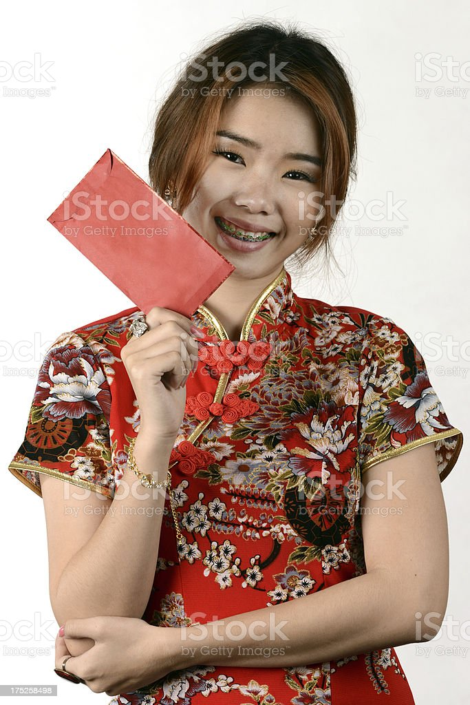 Happy Chinese new year by woman with red envelope royalty-free stock photo