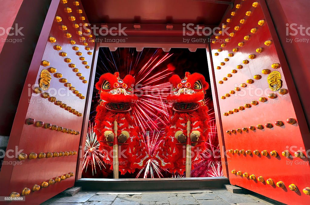 Happy Chinese New Year Chinese Lion Dance with firework in the background 2015 Stock Photo
