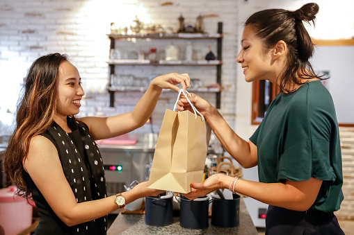 istock Happy Chinese woman receiving takeaway 1206954750