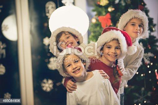 865399512istockphoto Happy Christmas children 493084906