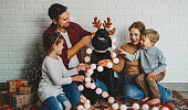 happy Christmas! family mother father and kids with dog before Christmas with garland gifts and tree