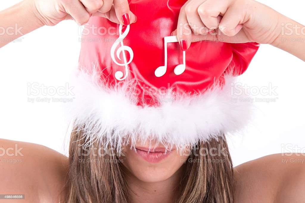 Happy Christmas Girl Showing White Musical Note stock photo