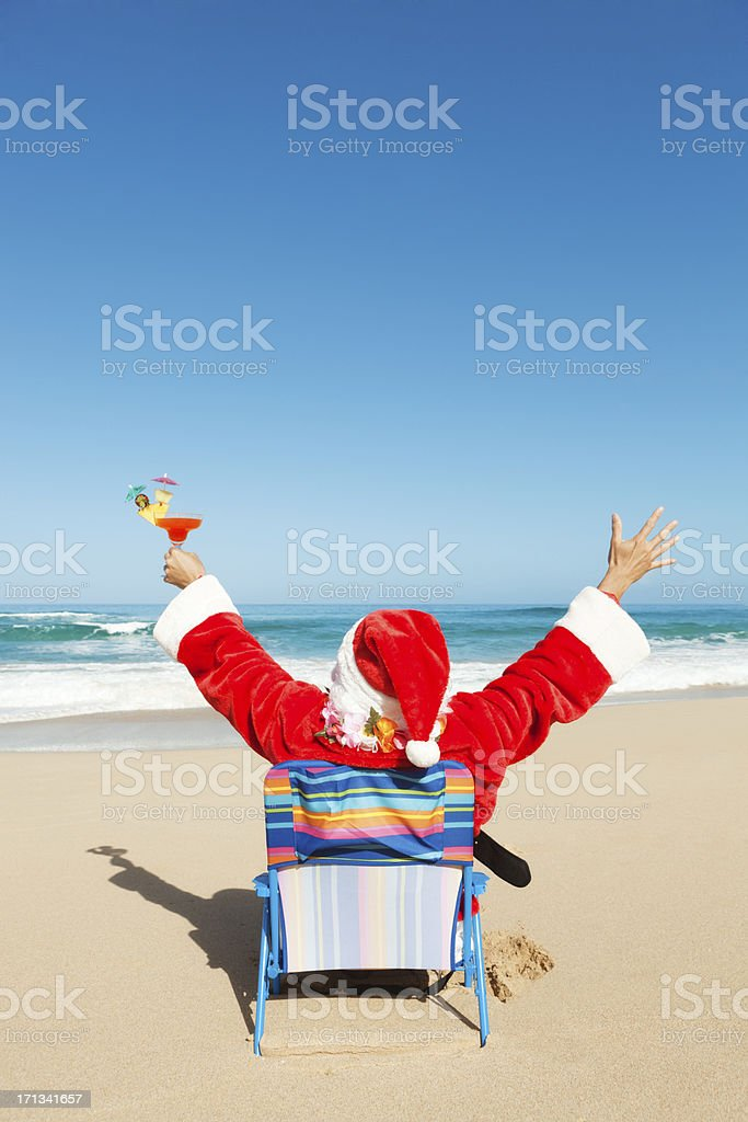 Happy Christmas Santa with Drinks Vacationing on Tropical Beach Vt royalty-free stock photo