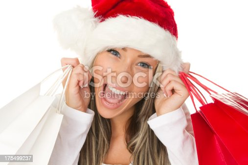 455111881istockphoto happy christmas shopper 175499237