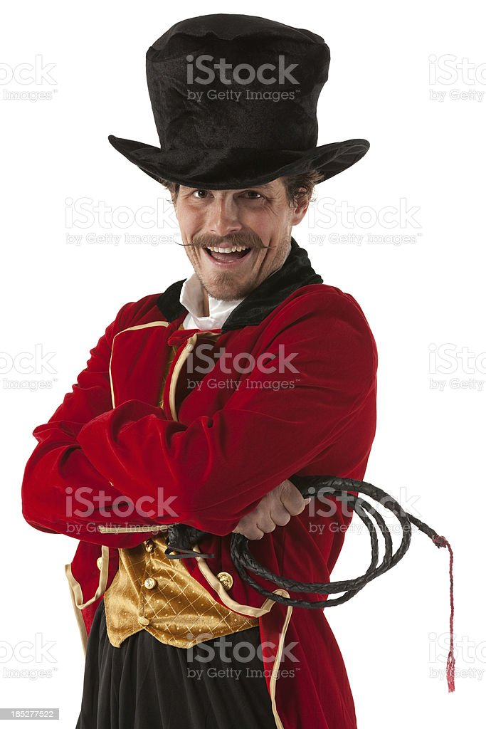 Happy circus ring master standing with arms crossed stock photo