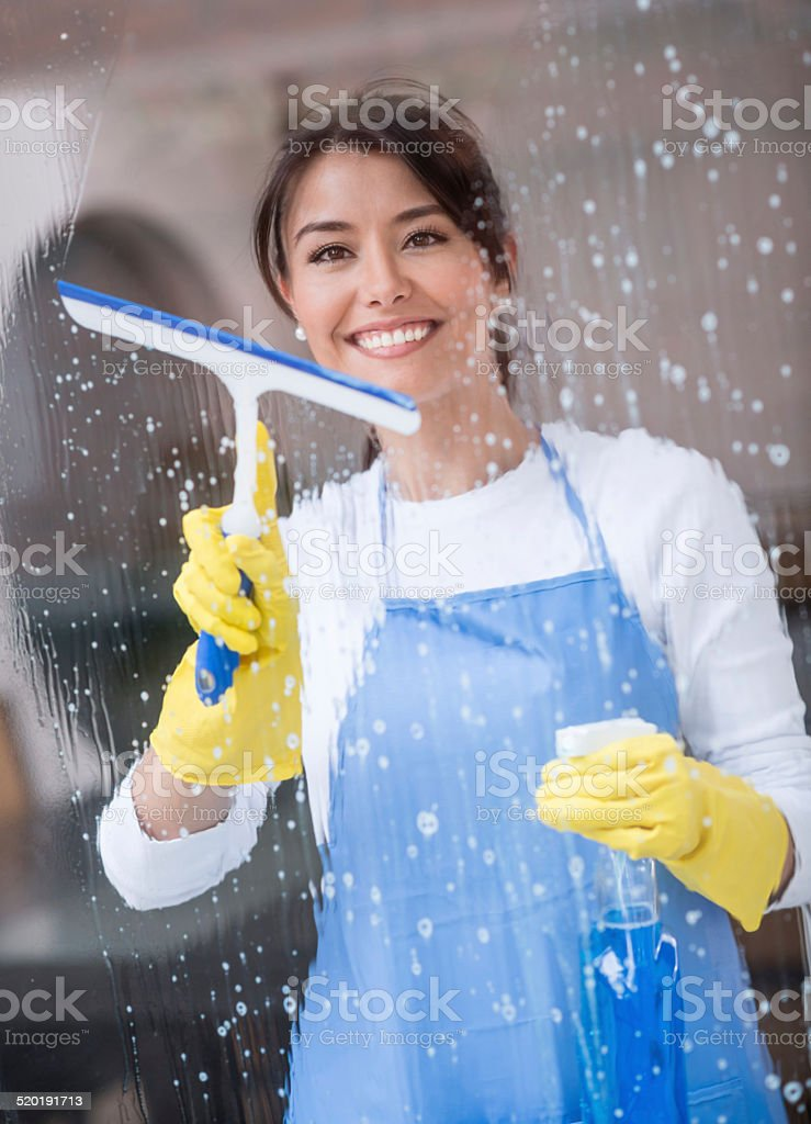 Happy cleaning lady stock photo