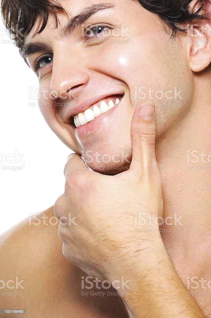 Happy cleanshaven male face with a toothy smile stock photo